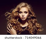 beautiful woman with long curly ... | Shutterstock . vector #714049066