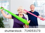 older patients in physiotherapy ... | Shutterstock . vector #714053173