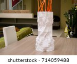 a large tall white vase printed ... | Shutterstock . vector #714059488