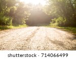 Sunlit Road To A Forest...