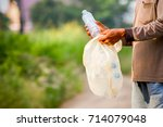 the man's hand is picking a... | Shutterstock . vector #714079048