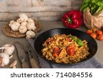 italian wholemeal pasta with... | Shutterstock . vector #714084556