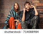 young fashion couple sitting on ... | Shutterstock . vector #714088984