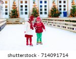 kids ice skating in winter park ... | Shutterstock . vector #714091714