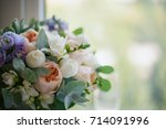 A Wedding Bouquet Lies On The...
