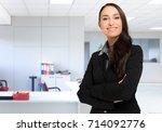 businesswoman in her office | Shutterstock . vector #714092776