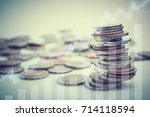 rows of coins with virtual... | Shutterstock . vector #714118594