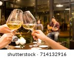 group of friend toasting with... | Shutterstock . vector #714132916