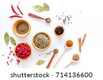 kitchen table with spices and... | Shutterstock . vector #714136600