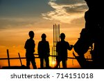 Small photo of Silhouette worker civil engineer and safety officer in industrial sector construction over blurred natural background sunset success team work business concept