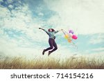 happy asian girl  playing with... | Shutterstock . vector #714154216