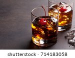 manhattan cocktail with whiskey.... | Shutterstock . vector #714183058