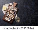 opened oysters  ice and lemon... | Shutterstock . vector #714183169