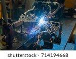 robot is welding an automotive... | Shutterstock . vector #714194668