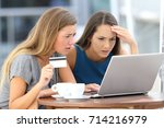two worried women having... | Shutterstock . vector #714216979