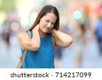 single woman suffering neck... | Shutterstock . vector #714217099