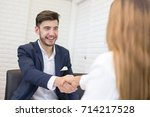 man with agreement for working. ... | Shutterstock . vector #714217528