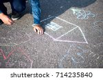 boy drawing with chalk home... | Shutterstock . vector #714235840