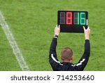 The referee shows the number...