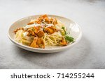 spaghetti with chanterelles and ... | Shutterstock . vector #714255244
