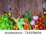 vegetables harvest raw eating... | Shutterstock . vector #714258634