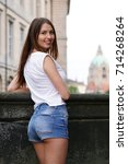 Stock photo young woman wearing hot pants while sightseeing in the old town of hannover germany with new city 714268264