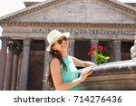 beautiful girl in blue dress... | Shutterstock . vector #714276436