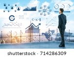back view of young businessman... | Shutterstock . vector #714286309