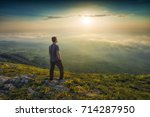 man standing on a mountain hill ... | Shutterstock . vector #714287950