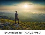 man standing on a mountain hill ... | Shutterstock . vector #714287950