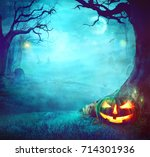 Stock photo halloween pumpkin in dark forest halloween background halloween pumpkin with graveyard 714301936