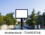 blank white billboard against... | Shutterstock . vector #714303718