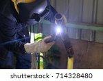 welder testing welding at... | Shutterstock . vector #714328480