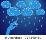 human hand touching a rain... | Shutterstock . vector #714340450