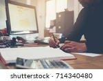 bussiness man writing a payment ... | Shutterstock . vector #714340480