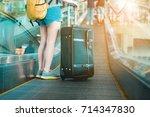 girl in airport. asian women... | Shutterstock . vector #714347830