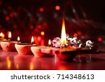 diwali greetings  diya lighting  | Shutterstock . vector #714348613