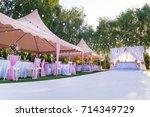 wedding banquet outdoor in... | Shutterstock . vector #714349729