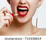 sexy woman lips with bloody... | Shutterstock . vector #714358819