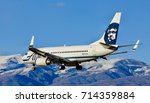 Small photo of SALT LAKE CITY, UTAH – April 16, 2016: A Boeing 737-700 of Alaska Airlines lands at Salt Lake City International Airport.