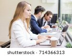 woman using laptop for work at... | Shutterstock . vector #714366313