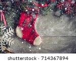 christmas sock on the wooden... | Shutterstock . vector #714367894