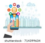 smartphone in hand helps to... | Shutterstock . vector #714399634