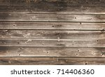 wooden wall with nails... | Shutterstock . vector #714406360