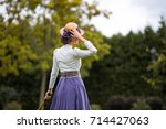 beautiful girl in a vintage... | Shutterstock . vector #714427063
