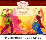 couple performing garba dance... | Shutterstock .eps vector #714432418