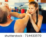 strong woman is training with... | Shutterstock . vector #714433570