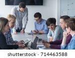business team meeting in modern ... | Shutterstock . vector #714463588