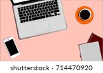 workplace with a laptop  cup of ... | Shutterstock .eps vector #714470920