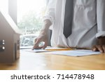 businessmen are doing... | Shutterstock . vector #714478948